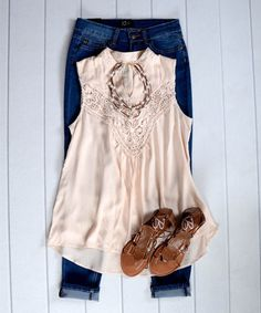 Really like this blouse. I like that it's sleeveless and feminine. Would pair with cropped jeans and sandals.