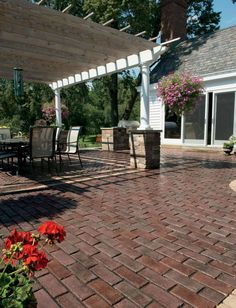 unilock outdoor living patio with fireplace featuring brussels