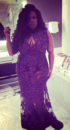 "Amber Riley - this in a champagne color and a longer ""slip"" underneath"