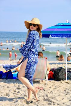 Beach outfit. Coverup, floppy straw hat, sunglasses.