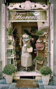Floral shop in Rome - photo by Karen Lewis This entrance is so so French.the use of the shutters and the display of the greenery.it looks so rustic. Quaint Florist Shop in Rome closed for afternoon siesta Vitrine Design, Deco Champetre, Shop Window Displays, Spring Window Display, Flower Shop Displays, Florist Window Display, Flea Market Displays, Antique Store Displays, Flower Shop Decor