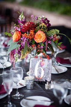 Colorful Fall Wedding in Pennsylvania, Purple and Orange Floral Centerpieces with Wooden Table Numbers   Brides.com