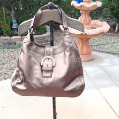 🎉HP 🎉💯AUTHENTIC COACH HOBO 💥Final Price 💥 Bag measures approx. 15 in (L) x 11 in (H) x 5 in (D) at the widest Soft Metallic Leather  Leather double straps with 9 inches drop for shoulder carry 3 compartment, the front one with buckle and magnetic closure with 2 slip pockets inside.  Middel one with zipper closure and inside 2 slip pockets.  Back one with snap closure and large inside zipped pocket/leather pull.   Matching plum fabric lining inside  Nickel hardware Coach leather hangtag…