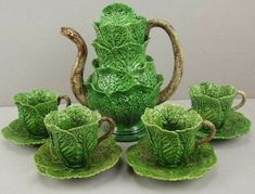 A nine piece Jose Cunha, Portugal Palissy Ware majolica pottery tea service with cabbage teapot, cups and saucers, snake handles. The snake in the cabbage leaf is a popular motif used by several Portuguese Palissy/Majolica makers. Ceramic Pottery, Ceramic Art, Earthenware, Stoneware, Teapots And Cups, Chocolate Pots, Cup And Saucer, Kitsch, Tea Time