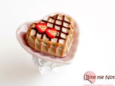 Waffle on a plate White color,filigree,nickel free,adjustable ring base,heart shaped waffle with strawberries and chocolate sauce on a pink ceramic heart shaped plate.