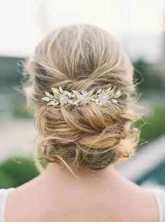 Elegant low crisscross bun bridal hairstyle | Photography: Erika Brown