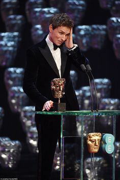 Amazed: Eddie Redmayne looked completely shocked to learn he had received the award for Leading Actor at the 2015 EE BAFTA awards on Sunday night.  Perfect suit too.