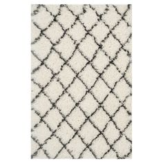 Add a touch of texture to your living room or den with this lovely loomed shag rug, showcasing a trellis motif for eye-catching appeal.   ...