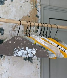 wire hangers with old wallpaper
