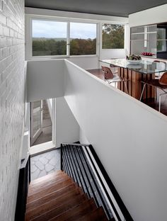 Marcel Breuer: The Stillman House | Wright. Love this dining room, kitchen and entry way. Just gorgeous.