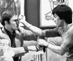 """Bruce Lee demonstrating Wing Chun to John Saxon on the set of """"Enter the…"""