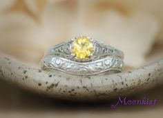 Size 7 - Yellow Sapphire Dainty Filigree Wedding Set in Sterling Silver by MoonkistGallery. This beautiful set features a 5 mm yellow sapphire, and a unique curved fitted wedding band! Visit moonkistgallery.etsy.com to see more pieces from this collection!  Repin this beautiful ring set to your own inspiration board!