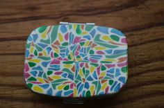 Hey, I found this really awesome Etsy listing at http://www.etsy.com/listing/129320927/stained-glass-polymer-clay-pill-case