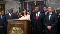 South Carolina Gov. Nikki Haley along with Sens. Tim Scott and Lindsey Graham (right, far right) and other lawmakers and activists call for the Confederate flag to be moved from state Capitol grounds.