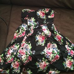 Black floral print short dress Black floral print short dress with built in bra. Only worn once .. No rips, no stains, it's like brand new Dresses