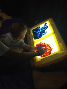Painting with a light box. An easy to make activity that is fun for children with vision impairments.
