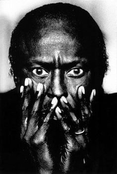 Anton Corbijn. Miles Davis, Montreal, Canada 1985. Taken in his hotel room with light falling in from the window. In his very large pupils you can actually make out my silhouette. It was a very brief shoot but one of the most satisfying ever. It is also worth noting that this photo was taken well before the TUTU album shoot by Irving Penn and it has become one of my most well- known photographs.