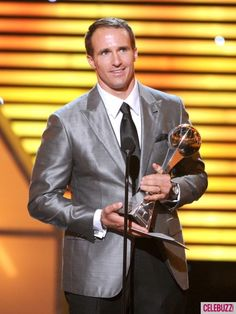 NFL player Drew Brees of the New Orleans Saints accepts the Best Record-Breaking Performance award onstage during the 2012 ESPY Awards at Nokia Theatre L. Live on July 2012 in Los Angeles, California. First Football Game, Pro Football Teams, Saints Football, Soccer Players, Saints Game, American Falls, Espy Awards, Sports Website, First Down