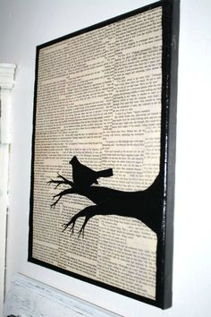 book pages decopaged on canvas