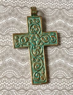 A personal favorite from my Etsy shop https://www.etsy.com/listing/534413021/cross-ornate-turquoise-blue-patina-over