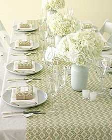 Here's a quick and inexpensive way to add style to your reception space: Use gift-wrap runners.