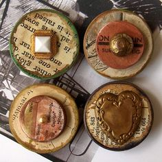 Buttons or I would also use FIMO baked glad and decorate with the shimmer dust