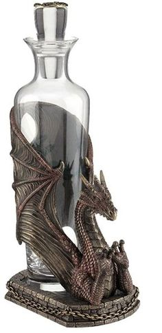 This unique decanter is perfect for a fantasy lover! A glass bottle sits snugly in the wings of a dragon. The visible half of the mythical beast rears back, displaying claws. It's stately and magical, and useful, too!