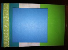 Sticky note holder from a $1 plastic frame and scrapbook paper :) for Levi's office