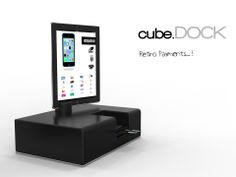 CUBE dock 01  . Contest RE-DOCK. RETRO PAYMENTS A Plastic shell that recalls the traditional cash register. In the product there is an area secure for Mpos use and the Ipad rotates 360°(vertical axis). There is also a compartment in a drawer helpful to the clerk.
