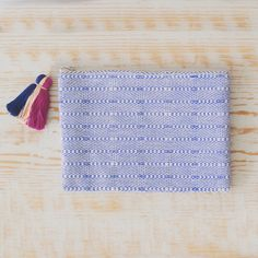 """Cobalt blue, brocaded clutch or cosmetic bag with multi-colored tassel.  Handwoven and sewn in Guatemala.7"""" high x 10"""" wide100% Cotton"""