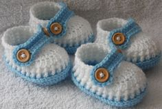 Handmade baby shoes with wooden buttons for your twins.    Baby shoes will keep your babies little feets cozy and warm.  Baby shoes look beautiful and