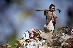 An illegal immigrant boy from Myanmar collects plastic at a rubbish dump site near Mae Sot December 22, 2009. Despite terrible living conditions and the fear of being sent back to their country, several hundred illegal immigrants from Myanmar live and earn an average of $1 per day collecting plastic at the rubbish dump near the border town of Mae Sot. Myanmar's long-standing political crisis has forced millions of people to cross the border for a better and safer life. (Photo by Damir…