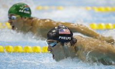 United States' Michael Phelps, front, and South Africa's Chad le Clos compete in the men's 200-meter butterfly swimming final at the Aquatics Centre in the Olympic Park during the 2012 Summer Olympics in London, Tuesday, July 31, 2012. Le Clos won gold, Phelps silver. (AP Photo/Matt Slocum)