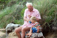 Grandparent and Grandchild having Tea on Beach royalty-free stock photo