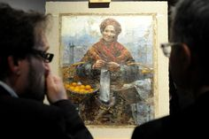 """WARSAW.- Visitors look at the 19th century painting """"Jewish Woman Selling Oranges"""" by Polish painter Aleksander Gierymski during the reopening of the National Museum after general renovation, on the 150th anniversary of the museum, in Warsaw, Poland. The painting that went missing during World War II was returned to Poland after being removed from an auction in Germany in July 2011, and now is shown to the public. AP Photo/Alik Keplicz."""