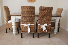 Farmhouse harvest boarded dining table and banana leaf dining chairs in white/ivory paint and dark walnut stain.