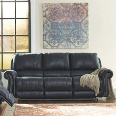 It's all in the details. And the Milhaven Reclining Sofa by Signature Design truly nails it with fashion forward elements including a picture frame bustle back, nailhead trim, padded, rolled arms and overstuffed cushions throughout. Leather Reclining Sofa, Navy Leather Sofa, Best Sofa, Signature Design, Recliner, Picture Frames, Sofas, Family Room