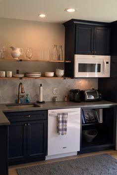 Floating shelves open up this in-law suite's kitchen, while our Belleair Maple cabinets in Naval add both style and storage. Basement House, Basement Kitchen, Basement Apartment, Kitchen Nook, New Kitchen, In Law House, Tiny House, Small House Floor Plans, House Plans