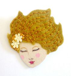 face felt, would be cool as a brooch or hair thing