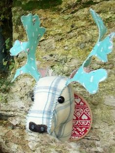 """Fabric Deer Head  Bustle and sew $4.50 How cool are these they are """"mounted"""" on an embroidery hoop and have wiring to keep the antlers up."""