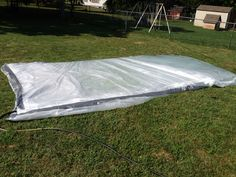 The outdoor water bed... Fun for kids play.  4 paint tarps and duct tape.  Fun fun!!!