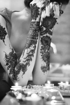 I believe that this is henna, or Mehndi(?) So gorgeous.