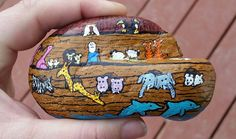Noah's ark. Horses, chickens, cows, rhinos, giraffes, dolphins, hippos, penguins, tigers, lions, polar bears,elephants, deer, doves, tucans, orcas, cats, dogs, bunnies, snakes, flamingos, penguins, camels, sloths. Painted Rock Stone Art by Ashley V Harcus. Sold before it was finished.