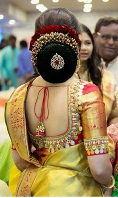 What a beautiful large low bun with gajra & juda pin! Care however should be taken before adopting such hairstyles, as due to it's high static charge, it will cause phlegm to move up in the throat, causing the voice to quaver & a frequent urge to clear the throat. A heavy chabi chhalla with a long & wide hook if inserted at the edge of the pleats of the saree, will reduce this problem as it's hook will activate the acupressure points that act to keep the throat clear. #beautyhairstyles