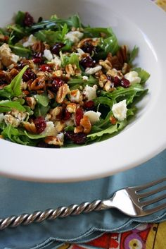 Baby Arugula, Cranberry, pecan and feta salad.  One of the best salads I've ever had.  Especially great with a light raspberry/walnut dressing