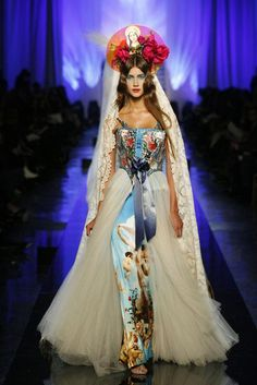 #women #fashion #elle #trend #clothing #inspiration #style #religion #god #cross #Jean Paul Gaultier is on trend with this dress. It's another art as fashion piece. It's ethereal and reminiscent of a village wedding to rural Italy.