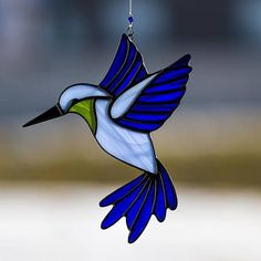 Hummingbird, stained glass hummingbird suncatcher, stain glass blue humming bird ornament on Etsy #StainedGlassFish