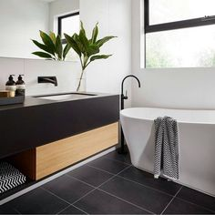 """R U S H ➕ V I V I D S L I M L I N E We absolutely love the black, white and timber styling in this stunning ensuite in The Langham 44 house from…"""