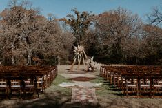 Rustic, bohemian outdoor wedding aisle and seating