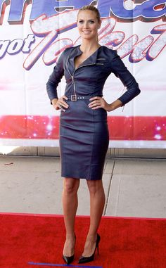Heidi Klum attends the America's Got Talent event in Illinois wearing a navy blue Thomas Wylde leather dress with sky-high black pumps.